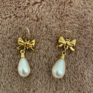 Gold and pearl pierced earrings.